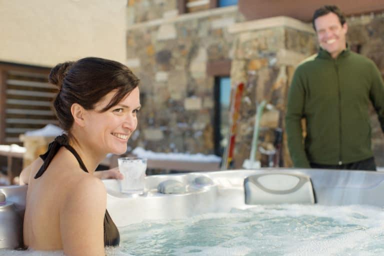 Woman soaking in hot tub.