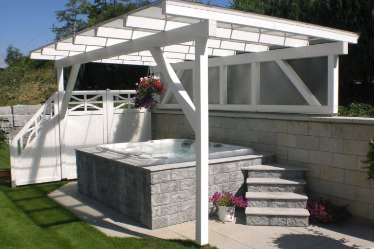 The Marin hot tub model in a modern backyard installation with a pergola.